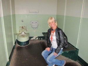 In a cell at Alcatraz anticipating a spanking!